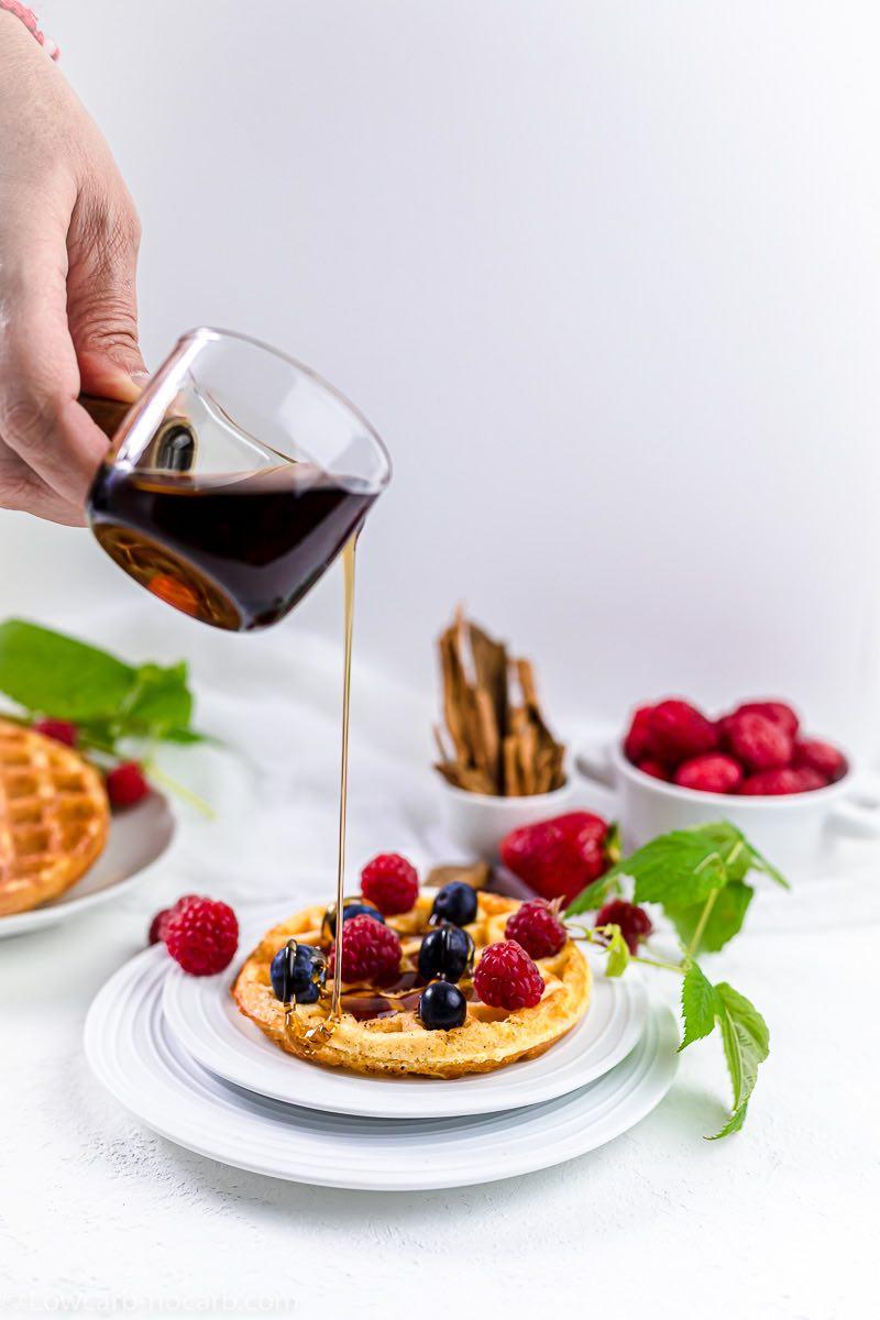 Keto Chaffle Breakfast poring the sugar-free sauce