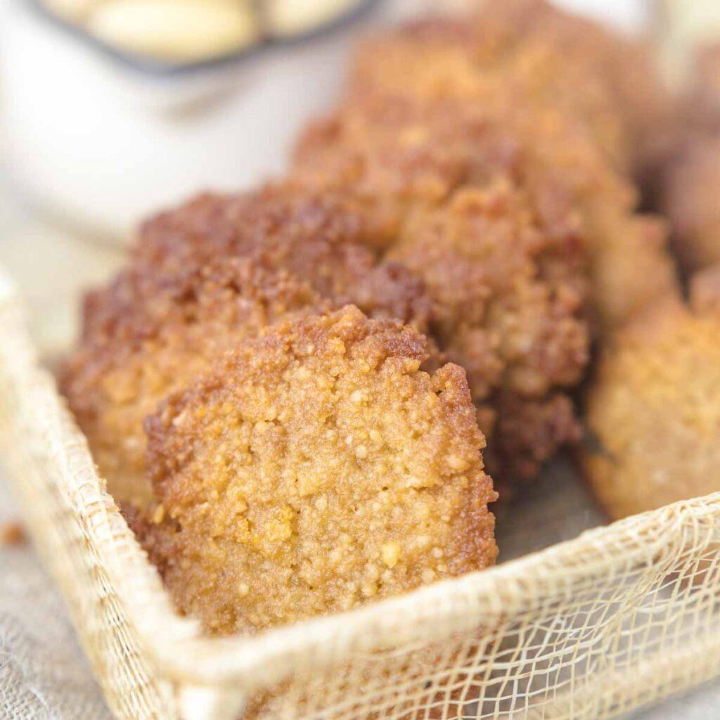 Almond Flour Keto Cookies placed inside a cream color thread basket