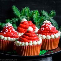 Keto Santa Cupcakes on a plate with green brunch behind