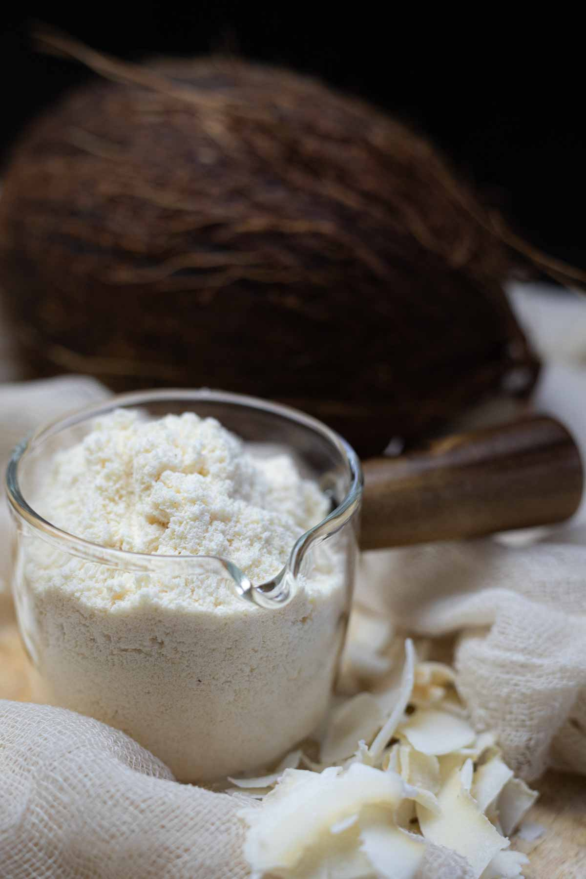 Coconut Flour for Keto flour substitute in a glass jug