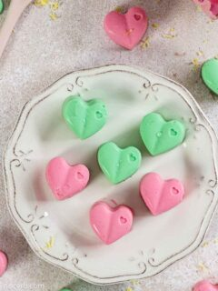 Heart shape Fat Bombs in pink and green colour on a plate