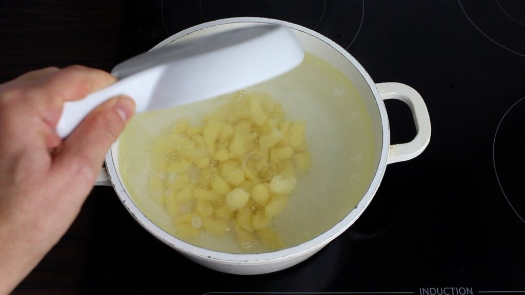 Basic Keto Gnocchi pouring into the boiling water