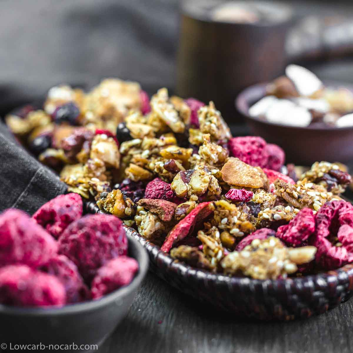 Homemade Low Carb Granola with dry Berries in a wooden bowl