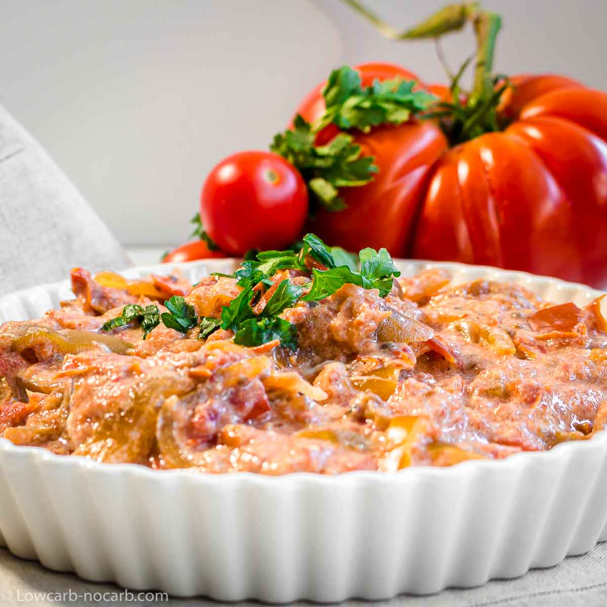 Lecso Vegetable Stew in a white casserole with Meat tomato behind