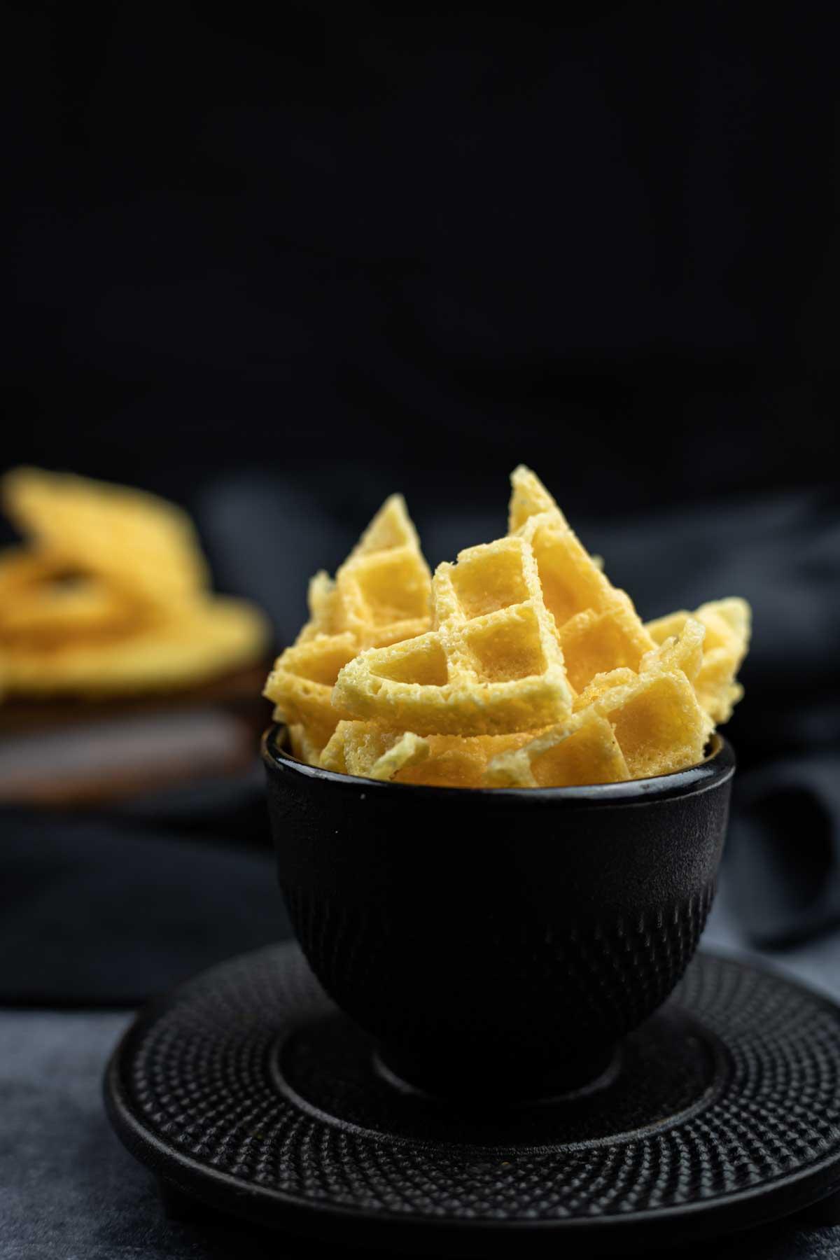 Keto Guacamole Chips in a black bowl