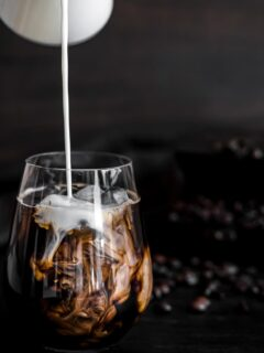 Keto Cold Brew Coffee with milk pouring into the glass