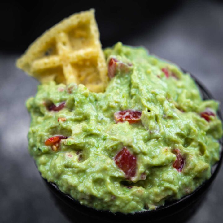 Keto Guacamole Dip Recipe close up with a Keto Snack dipped in