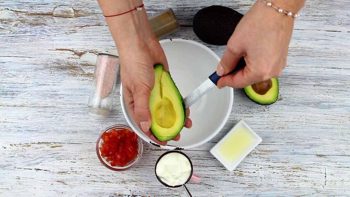 Easy Keto Guacamole Dip cleaning avocado