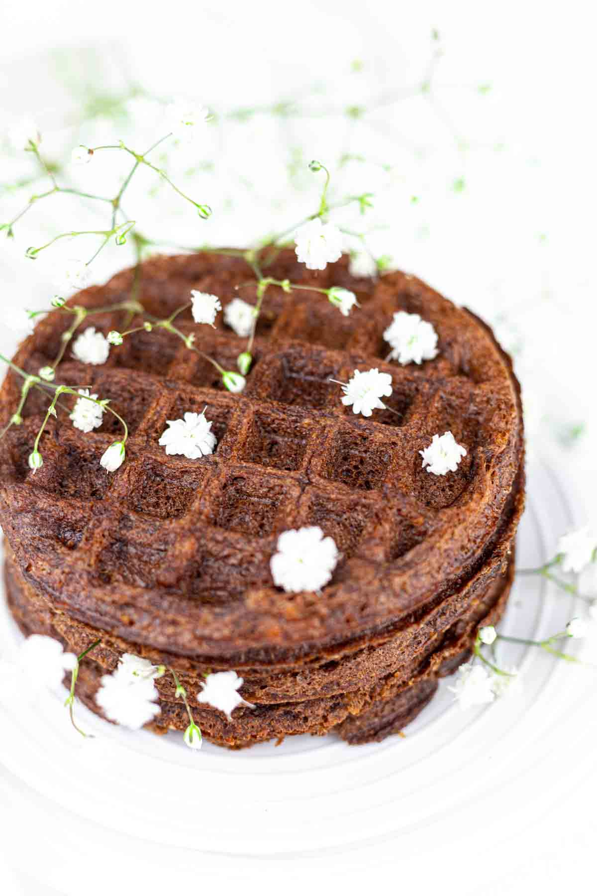 Chaffles with Cream Cheese on a white plate