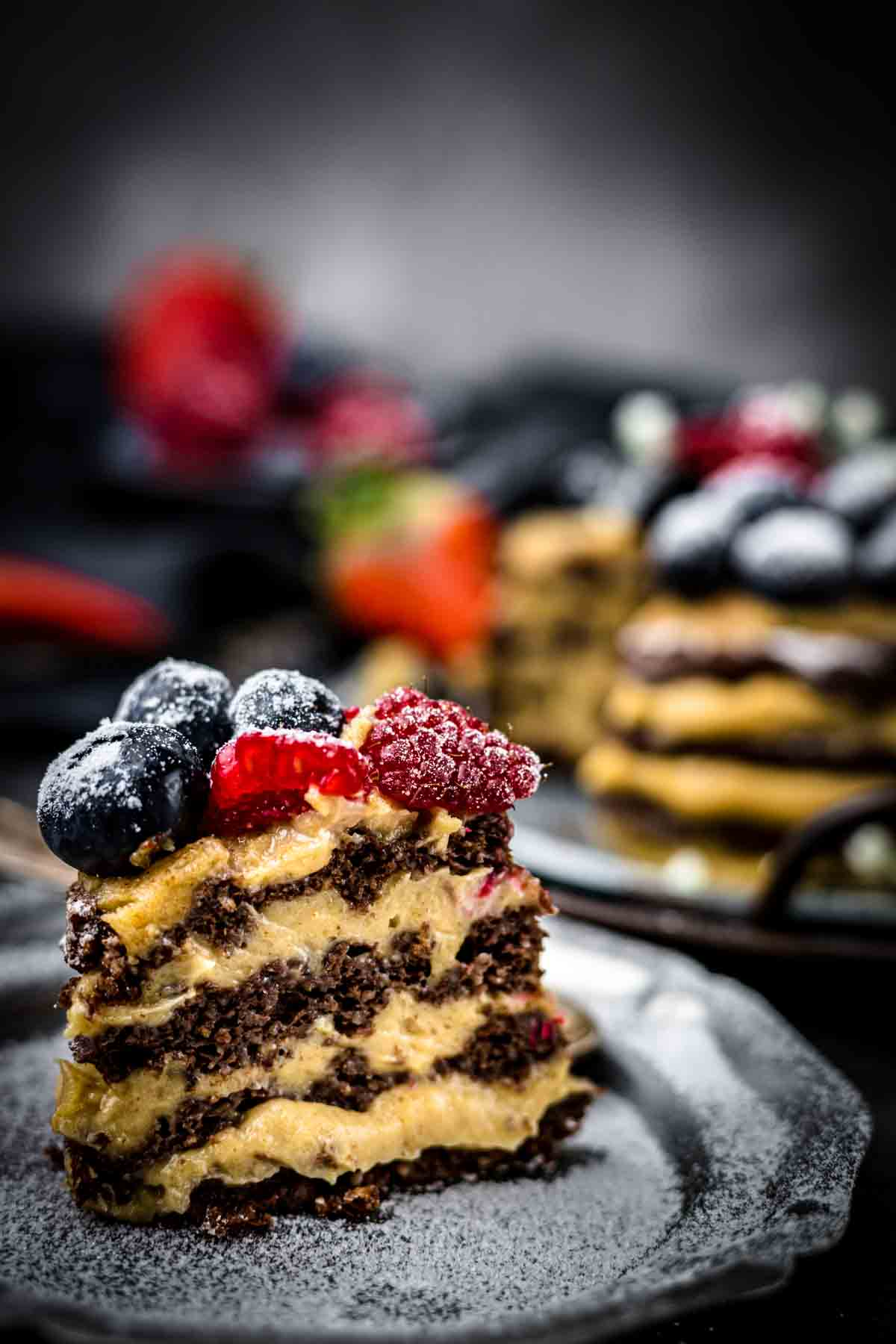 Keto Chocolate Cake single piece on a grey plate