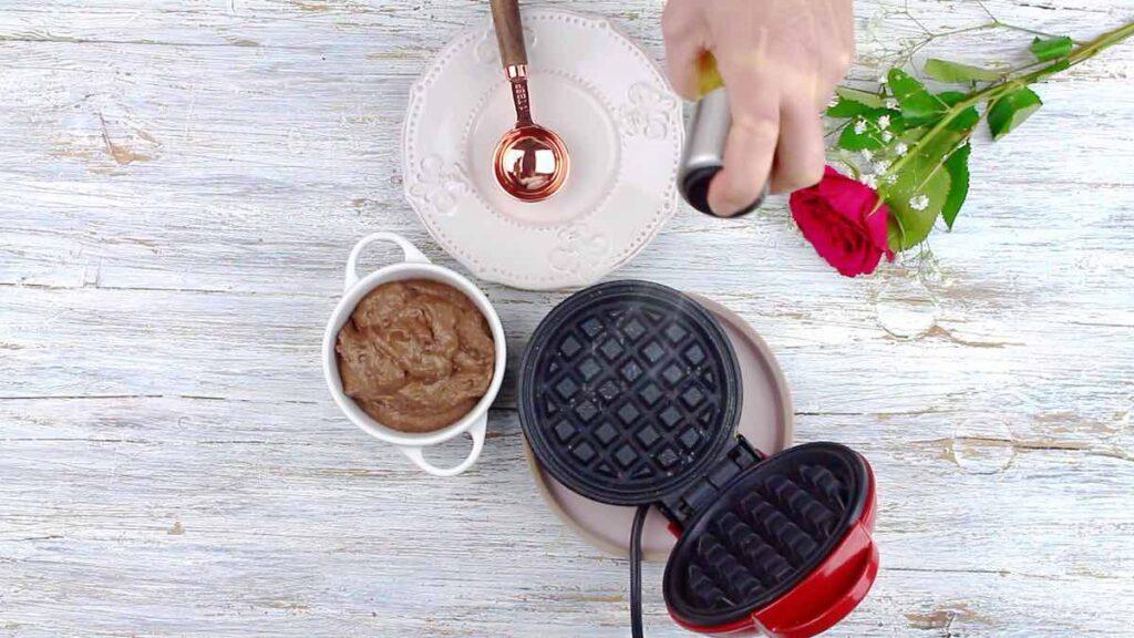 Quick and Easy Keto Chaffles spraying Dash mini waffle maker