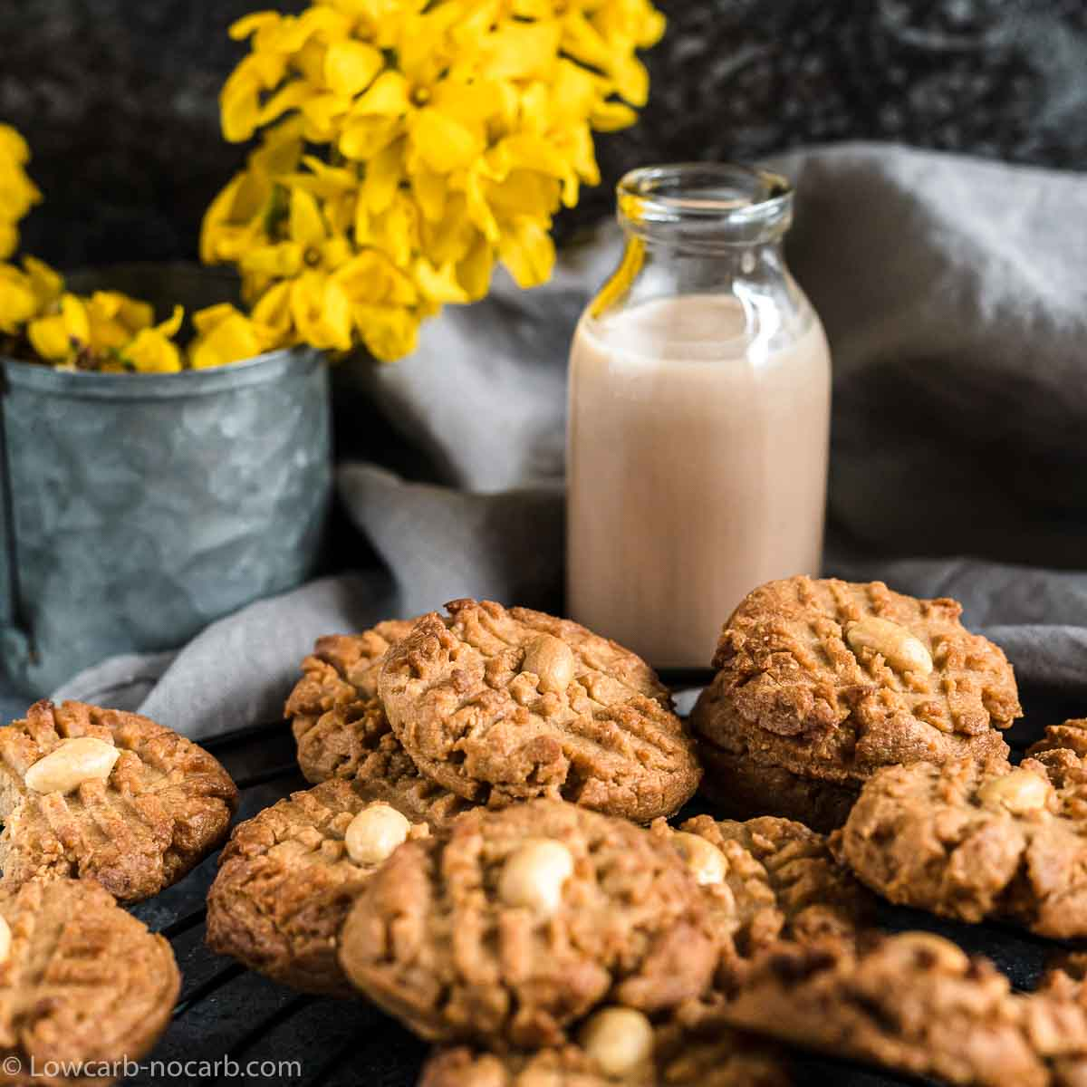 Eas Peanut Butter Cookies spread with peanuts on top