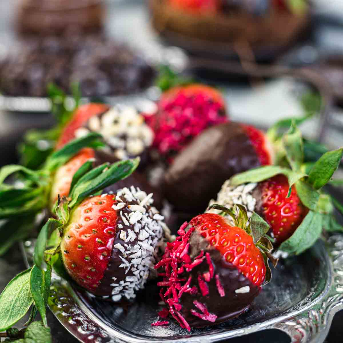 How To Make Keto Chocolate Covered Strawberries on a silver plate