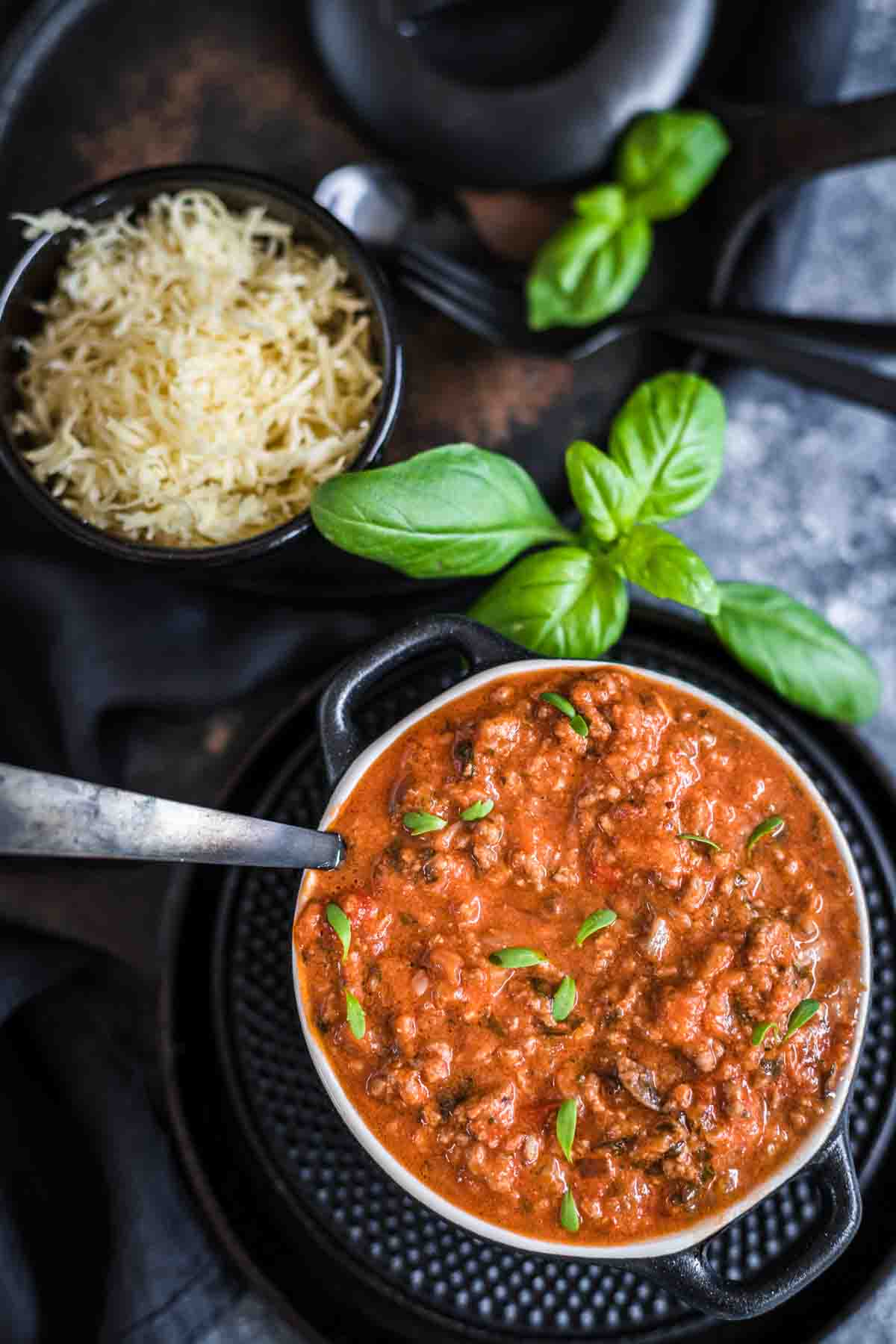 Keto Beef Bolognese ready to serve in a dark bowl