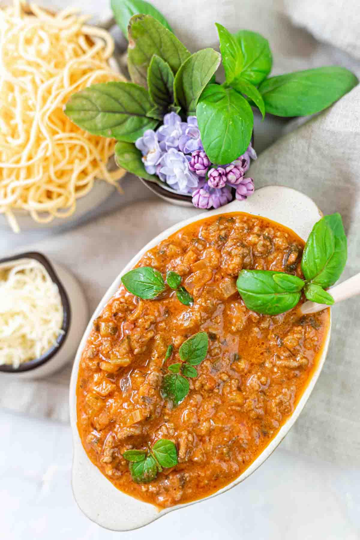 Keto Spaghetti Sauce in a cream dish