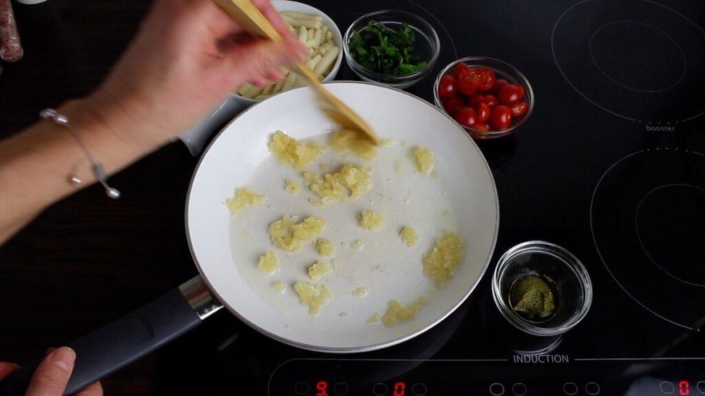 Keto Gnocchi Tomato Basil cooking crushed garlic