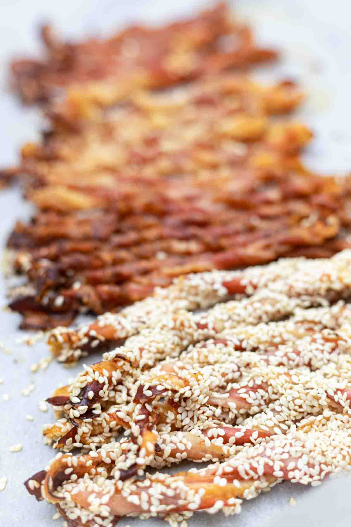 Crispy Twisted Bacon spread on a parchment paper