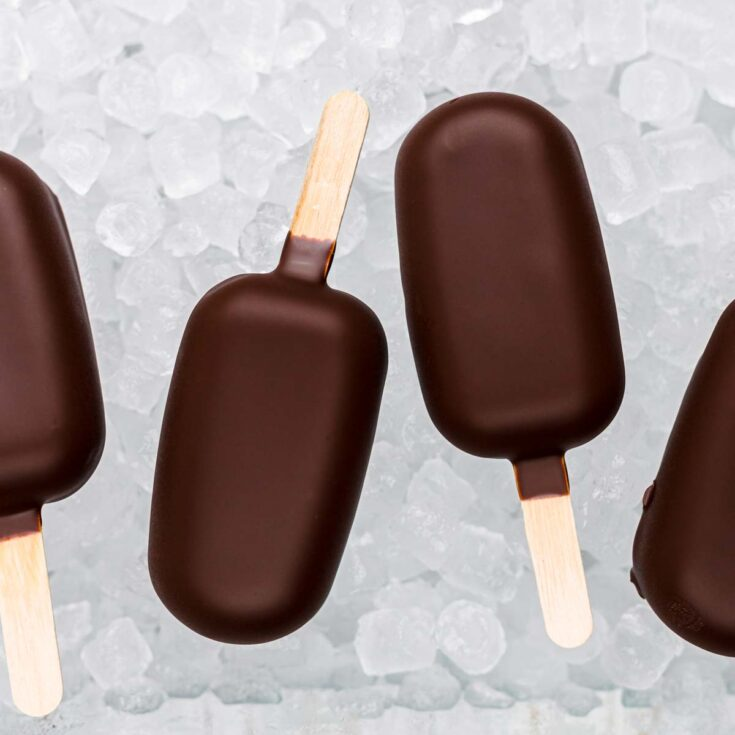 Natural Protein Keto Popsicles layered on ice cubes