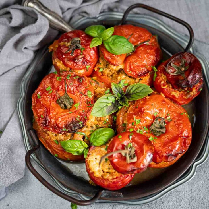 Mince Stuffed Tomatoes served on an old silver rounded plate
