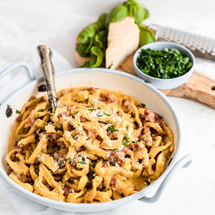 Keto Carbonara No Cream on a plate with herbs and cheese