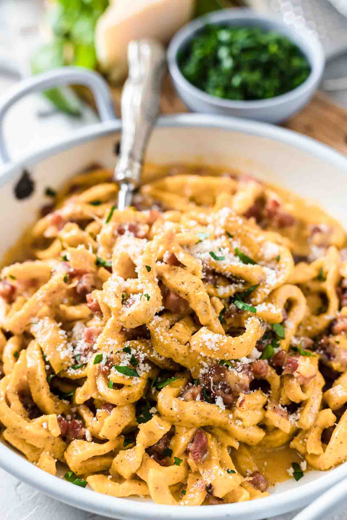 Keto Pasta Carbonara on a white plate with bacon and parmesan