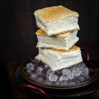 Sugar-Free Ice Cream Sandwich on a dark plate with ice cubes
