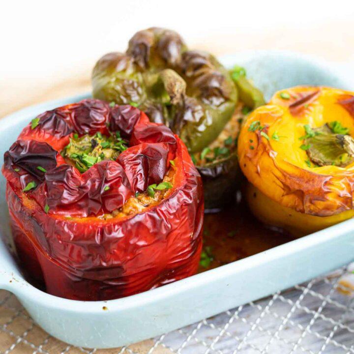 Keto Stuffed Bell Peppers inside a light blue baking casserole