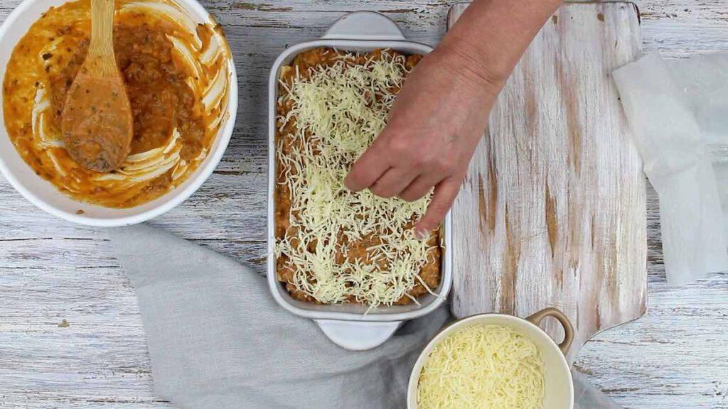 Easy Lasagna Recipe sprinkling cheese