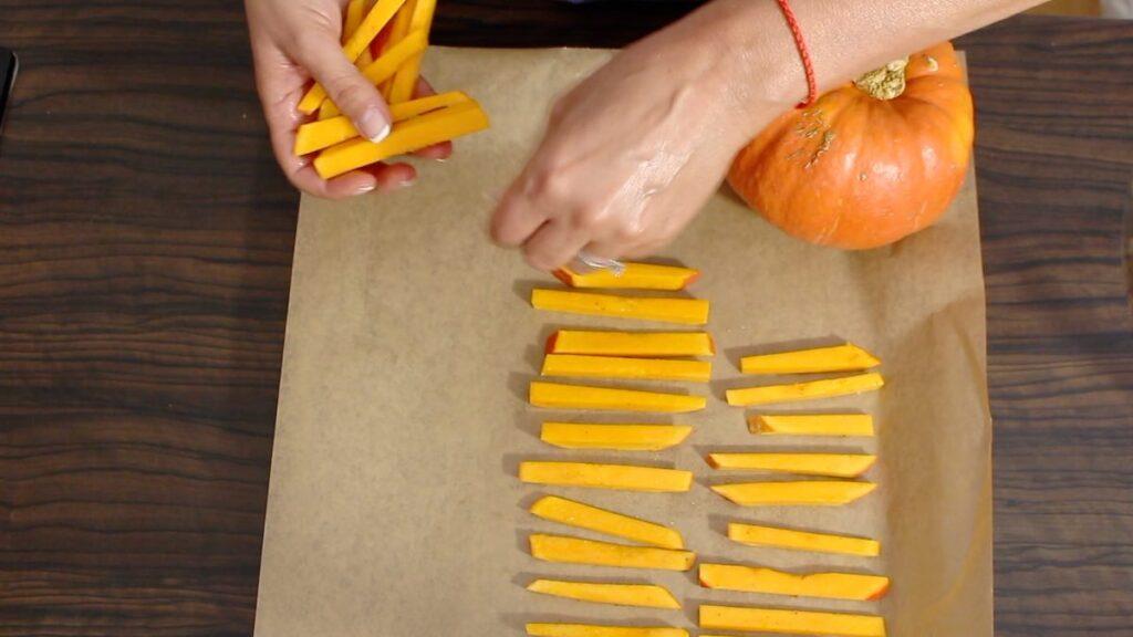 Pumpkin Chips being layered onto the baking sheet