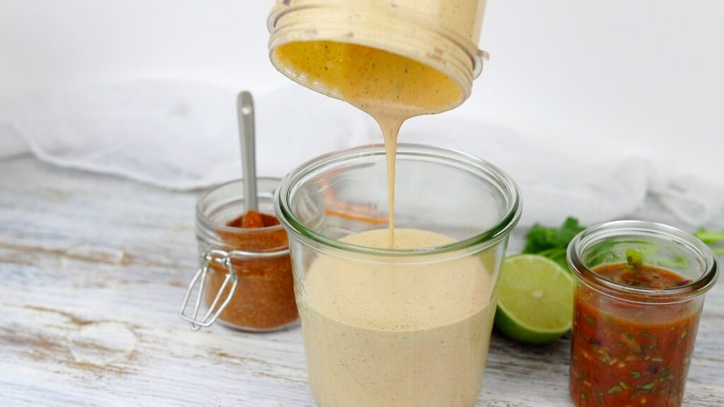 Creamy Salad Dressing pouring into the glass